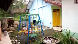Shared playground with the local kindergarden group - note broken debris and rubbish everywhere